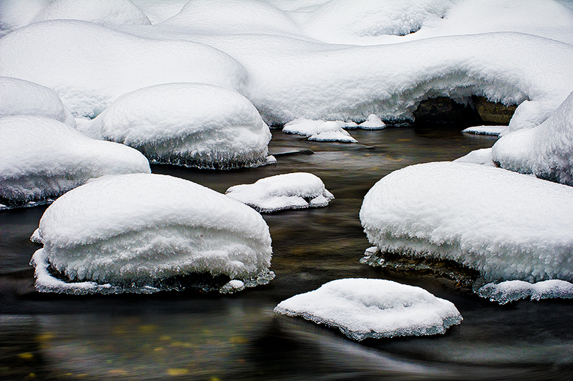 Snow on Stream Rocks